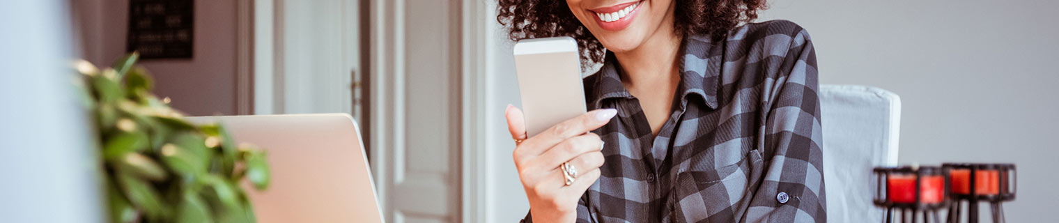 Woman looking at phone at home